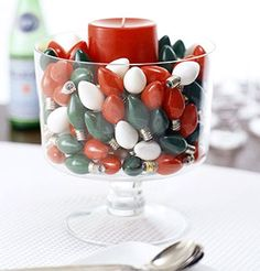 Cute idea to use Christmas lightbulbs in a hurricane vase.