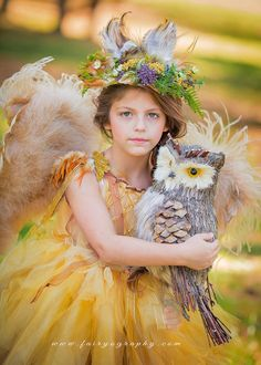 Heather Larkin is the photographer behind Fairyography. She specializes in fantasy photo sessions, using costumes, glitter, props, filters, a lot of imagination and talent. With her magic, she turns little girls and boys from two to twelve into angels, princesses, fairies, angels, and elves.