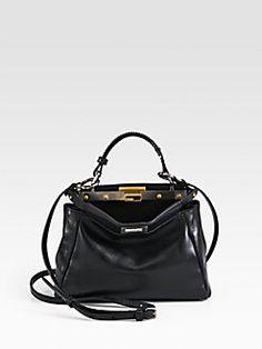 Updated as of September 2014 Introducing the Fendi Peekaboo Mini Bag.  Fendi s iconic Peekaboo bag comes in a pint sized mini version. The mini bag  has all 57311655f8f61