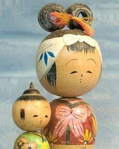 Old kokeshi dolls.
