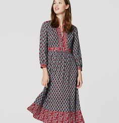 """With beautifully harmonious prints and a dreamy, flowy skirt, this midi captures the perfect autumn romance. Split neck with ties. 3/4 sleeves with button cuffs. Shirred beneath waist. Back zip. 33"""" from natural waist."""