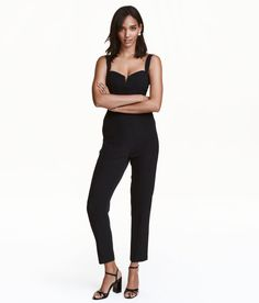 Check this out! Jumpsuit in woven stretch fabric with wide, adjustable shoulder straps that can be crossed at back. Silicone trim inside upper edge, boning at sides of bodice, and elastic sections and concealed zip at back. Seam at waist and tapered legs. - Visit hm.com to see more.