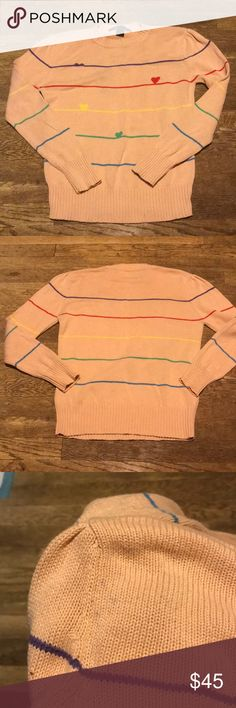 Marc Jacobs Sweater with hearts and stripes This is one of my favorite sweaters of all time!! So cute. It's a tan Marc Jacobs 100% cotton sweater with rainbow stripes and hearts.  The back shoulder has a few dark spots- I pictured them, but they aren't really noticeable. The sweater has slight puff sleeves.  I only wore this sweater a handful of times so it is EUC.  It's a score🤩 Marc Jacobs Sweaters Crew & Scoop Necks