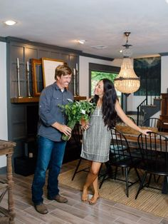 Is Chip swept up in a romantic moment or simply up to something? Either way, he looks a bit like the proverbial cat-who-swallowed-the-canary as he presents Joanna with a bouquet at the newly renovated home of newlyweds Jeff and Sara.