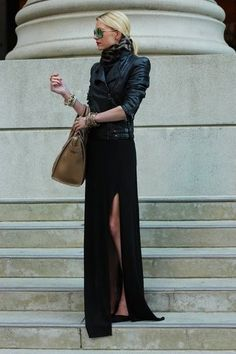moto jacket, scarf, and long skirt with deep slit.