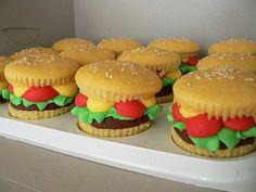 Chocolate buttercream hamburger patties with vanilla buttercream lettuce, tomato, and mustard