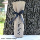 """Burlap Wine Bag, Mini Champagne Bag, Rustic Wine Bottle Bag  This MINI burlap bags perfectly fit wine bottles, olive oil bottles, beer bombers and many other things! Wrapped with a black satin ribbon, these make for beautiful gifts, centerpieces or wedding favors. This bag made of natural burlap,  with hand painted """"Salute"""" sign the front in black- but I can paint your initials, any saying, name, as a part of a custom order.  If you need a quantity other than shown please convo me a..."""