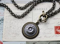 A simple Modern piece, this mixed metal, silver and gold Sunflower Necklace is perfectly conceived and executed for everyday wear. The pendant is a large 1 1/2 of multi mounted Sunflower button and hangs from an antiqued silver chunky rollo chain with an antique gold toggle clasp closure. Substantial and beautifully made. This is the perfect go to necklace.  See the drop down menu for length options. Order shorter for a choker style or longer as your preference.  More Button Jewelry http...