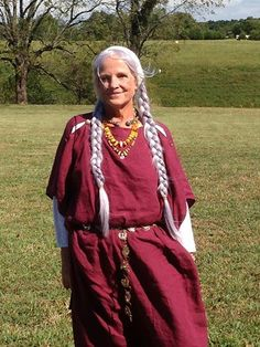 Wine linen early Celtic dress.  Belt is bronze with Scythian stages and knotwork.
