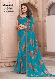 Buy this Scenic Blue #GeorgetteSaree and Dark Brown Fancy Jacquard Blouse along with Rawsilk Lace Border from Laxmipati Saree. #Catalogue #JAMUNIA #DesignNumber: 4537 #Price - ₹ 1475.00  #Bridal #ReadyToWear #Wedding #Apparel #Art #Autumn #Black #Border #MakeInIndia #CasualSarees #Clothing #ColoursOfIndia #Couture #Designer #Designersarees #Dress #Dubaifashion #Ecommerce #EpicLove #Ethnic #Ethnicwear #Exclusivedesign #Fashion #Fashi Laxmipati Sarees, Georgette Sarees, Indian Sarees, Silk Sarees, Saris, Saree Models, Saree Shopping, Elegant Saree, Chiffon Saree