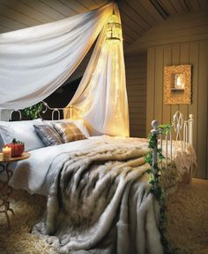 Good night. Under the fairy light, lies a bed full of linens in gold and white