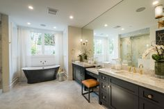 Traditional Master Bathroom with Double sink, Complex marble counters, High ceiling, complex marble tile floors, Wainscoting