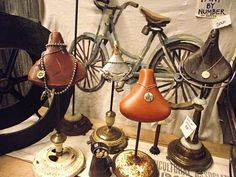 Bike seats attached to old stands, use for displaying jewelry or other trinkets.  Such a clever idea!