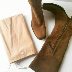✔ Prada  Miu Miu Brown Suede Cowboy Boots & Dust *Authentic Miu Miu Boots *Lucious Brown Suede Leather  *Classic Cowboy Square Toe Style  *Tiny Scuff on Heel *Gorgeous Tassel Zipper Pull *Half Zipper *Excellent used condition  *Size Italian 36.5  ***Please feel free to ask any questions or send me an offer!  share for Share  Ask Questions Make Offers  Like for future Price Drop Notifications   Purchase with confidence your item will be shipped with care! Miu Miu Shoes