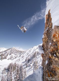 Ground control to Major Tom; photograph by Kevin Winzeler. Athlete Noah Wetzel gets updside down with a monster backflip in the Rocky Point backcountry at Alta Ski resort in Utah.