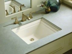 Kohler Memoirs undermount sink. Make sure you choose your sink and toilet from the same manufacturer. Kohler's white is not the same as Toto's white.