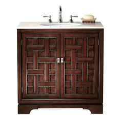 """Fairhaven Single Vanity, 34""""Hx33""""W, DARK WALNUT by Home Decorators Collection. $549.00. 34""""H x 33""""W x 20.5""""D.. The lovely Fairhaven Single Vanity is a masterpiece in refined woodwork. It makes for a great start for re-doing an old bathroom or finishing a new one. Get started on your bathroom by purchasing the Fairhaven Single Vanity today. Available in a dark walnut finish. Material: Solid poplar and birch veneer. Actual size is 34""""Hx33""""W"""
