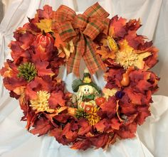 """Fall scarecrow wreath. Red, yellow maple leaves, vegetables and mums cover 16"""" grapevine form. Stuffed scarecrow with harvest veggie, cones. by KhQualityCreations on Etsy"""