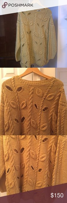 Authentic DKNY Jeans long sleeve Sweater Authentic DKNY Jeans 100% wool gold long-sleeve crew-neck sweater with cut-out leaves. DKNY Sweaters Crew & Scoop Necks