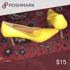 Shoes NWOT, yellow pumps, heal is perfect size. I just noticed the have a mark on them . Don't know how because I never worn them. Shoes Heels