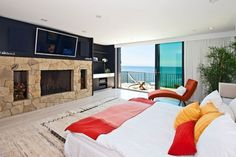 Investing in a Multi-Million Stony House in Malibu: Bedroom In Multi Million Dollar House With Fireplace Dream Beach Houses, Luxury Homes Dream Houses, Dream Homes, Malibu Beach House, Miami Beach, Luxury Mansions For Sale, Modern Castle, Inspired Homes, Home Theater