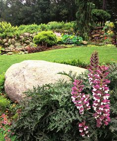 look at the use of stones,rocks, walls in a garden dreamy!