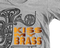 BAND HUMOR Funny Jokes T shirt. Kiss My Brass. Marching Band Tuba, French Horn, Trombone, Trumpet. Band Geek Music Symbols notes mellophone