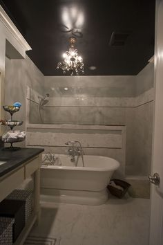 considering doing a black ceiling in my bathroom...but consider my bathroom is about 1/4 the size of this one...