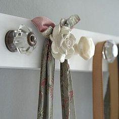 OUR BEDROOM: Vintage/Mismatched doorhandles as coat hooks on back of door.