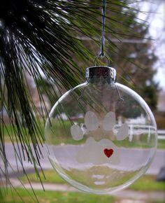 etched glass paw print ornament, cat ornament, dog ornament, pet ornament, christmas decoration. $10.00, via Etsy.