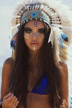 indian headress colors. the girls face looks weird. derpin