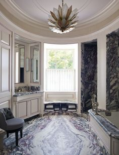 Who knew marble could look like this? The bathroom floor, tub deck, and walls are amazing!