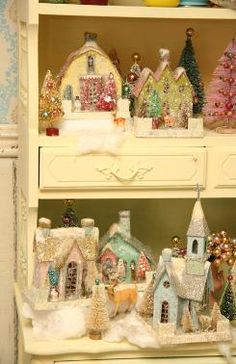 vintage glittered houses and churches - This links to the site of Cody Foster, a very whimsical and talented Christmas decoration creator. I LOVE these little houses and the bottle brush trees...takes me back to my youth.