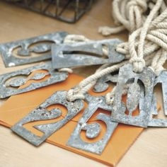 Ballard Design knock-off 'metal' number tags with polymer clay and mod podge metal look paper