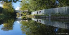 Jogging on the Leeds & Liverpool Canal, Burnley, Lancashire, England. 8th October 2015.