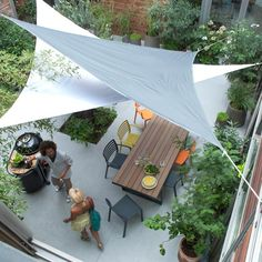 A refreshing patio garden with shade sails #patio #garden