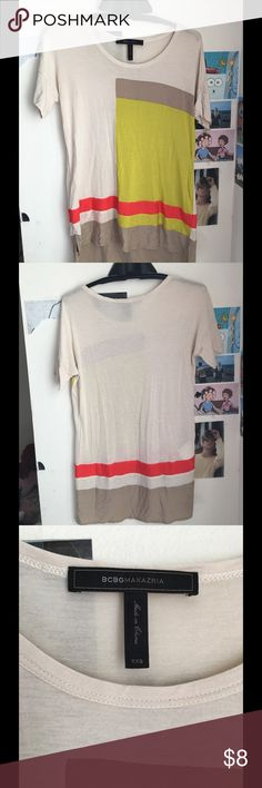 Stylish top Long, it will cover your bosom in the back, great for a casual look. BCBGMaxAzria Tops Tees - Short Sleeve