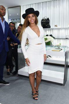 Beyoncé looked stunning in a fitted white crop top and matching high-waist skirt, which she accessorized with a black wide-brimmed hat and, of course, a pair of hot heels from Giuseppe Zanotti.