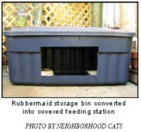 Inexpensive stray cat shelter and feeding station made from a Rubbermaid container.