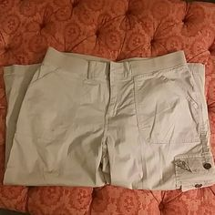 Khaki capri pants Size 16 PLEASE NOTE - missing buttons at waist.  No town fabric easily repairable. Super comfy khaki capri pants worth huge pockets at top and midway down leg.  Adjustable length with button and strap.  In good used condition(aside from button at waist) Smoke free home Lee Pants Capris