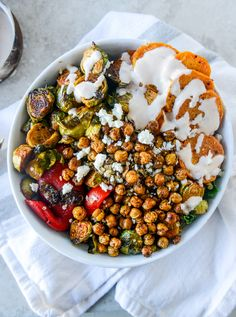 healthy snacks - Grain Bowls with Maple Chipotle Brussels and Coconut Roasted Sweet Potatoes How Sweet Eats Quinoa Sweet Potato, Roasted Sweet Potatoes, Cookies Banane, Feta, Vegetarian Recipes, Healthy Recipes, Vegetarian Dinners, Vegan Meals, Clean Recipes