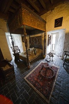 Medieval bedchamber! Love the floor, bed, and that sweet cradle. If only my husband would go for a look like this when we build our house.... We will see ;)