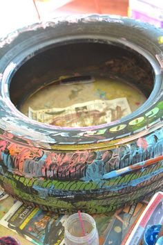 Tire Painting is so much fun! Nothing like reinventing the wheel with kids!  What would you do with a painted tire?
