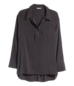 Check this out! CONSCIOUS. V-neck blouse in sheer woven fabric. Long sleeves with button at cuffs. Slits at sides and slightly longer back section. Made partly from recycled polyester. - Visit hm.com to see more.
