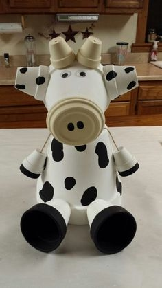 A Cow made from clay pots