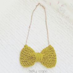 """I am loving these knitted bow necklaces!!! They will be up on my Etsy Shop shortly. You can choose from 24"""" or 30"""" and there will be a variety of chain styles and of course bow colors! I'm so excited! #bettyloops #etsy #etsyshop #supportsmallbusiness #shopsmall #etsyusa #etsyforall #etsyfavorites #etsyelite #summer2015    COLOR is Gypsy Gold   """