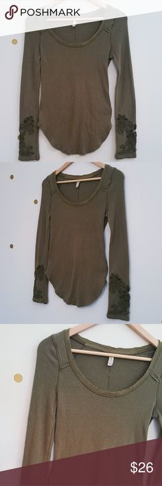 Free people masquerade cuff thermal top Blend of cotton, polyester and spandex. Has so many pretty details especially the cuffs  EUC. No piling or major signs of wear  Olive green Free People Tops
