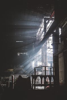 Sun ray push through the metal frames of the Belgium HF6 factory. [OC] [1067x1600]