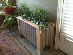 wood plank and tin planter box - link multiple boxes together to make a fence/barrier. wood plank an Diy Wood Planters, Galvanized Planters, Balcony Planters, Galvanized Metal, Balcony Garden, Garden Planters, Planter Ideas, Garden Boxes, White Planter Boxes