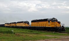By shere luck I was traveling just south of Sioux Center, IA on a day in July 2014 when I ran across this gravel drag being lead by Dakota and Iowa Rail, a short line, SD 40-2 #3030. That unit was followed by SD38 #4027, SD 40-2 #3029 amd SD38 #4028. These units by the way were on the main line, Marshall Sub of the BNSF.